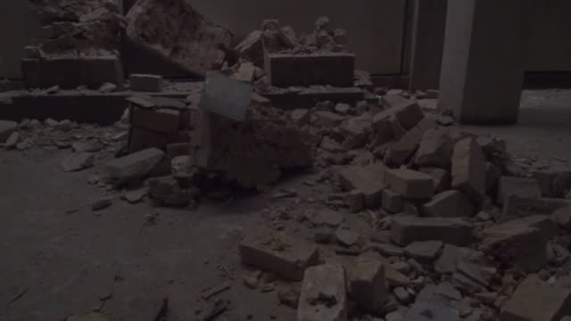 iraqi soldiers inspect mosul museum damaged by daesh terrorists in the clashes between iraqi army and daesh terrorists during the operation of iraqi... - mosul stock videos and b-roll footage