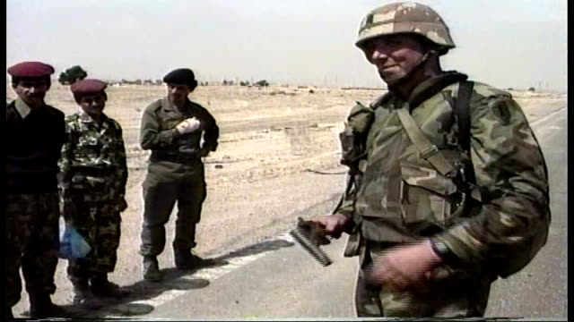 iraqi soldiers lined up on the side of the road as us troops search them they get into truck and drive away - operation desert storm bildbanksvideor och videomaterial från bakom kulisserna