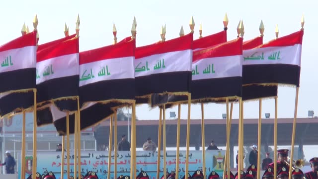 Iraqi soldiers march during the Iraq's armed forces' 96th anniversary celebrations at the Rustamiyah military camp on the southeastern outskirts of...