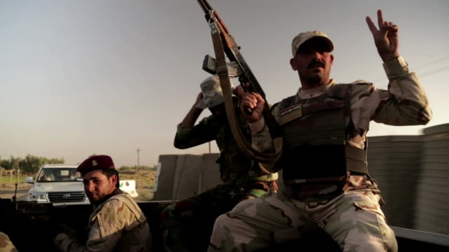 Iraqi soldiers on their way to hold the last defences between Baghdad and Islamic State fighters