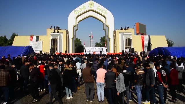 iraqi students at the university of kufa rally in support of ongoing anti government demonstrations at the campus gate in kufa city 10 kms northeast... - najaf stock videos & royalty-free footage