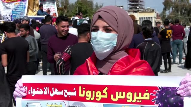 iraqi students take to the streets in karbala wearing masks as iraq has confirmed novel coronavirus infections among people arriving from iran - karbala stock videos & royalty-free footage