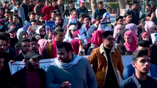 iraqi students take to the streets in the holy iraqi city of karbala to protest against the us and iran's interference in iraq - karbala stock videos & royalty-free footage