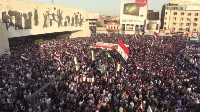 iraqi supporters of cleric moqtada al sadr wave their national flags and shout slogans during a demonstration in central baghdad to demand electoral... - muqtada al sadr stock videos & royalty-free footage