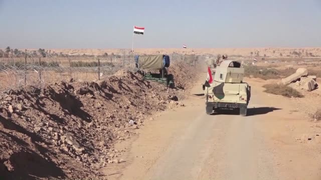 iraqi troops reinforce their positions along the porous frontier with neighbouring war torn syria fearing a spillover from clashes there between... - porous stock videos & royalty-free footage