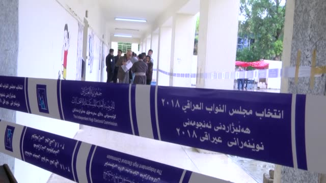 Iraqi voters cast their ballots in the parliamentary elections at a polling station in Erbil on May 12 2018 Iraqis began voting in the country's...
