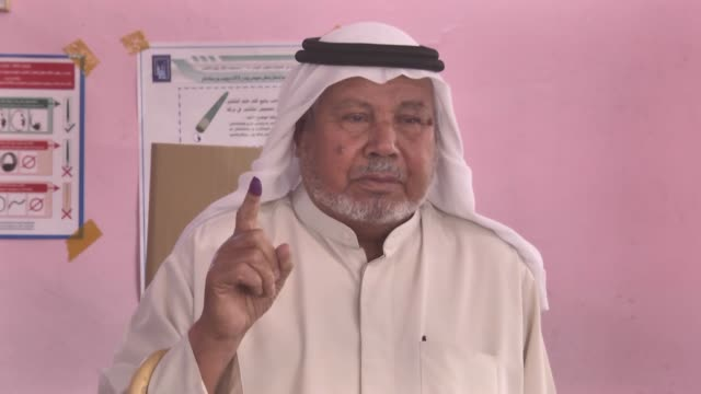 Iraqi voters cast their ballots in the parliamentary elections at a polling station in Kirkuk on May 12 2018 Iraqis began voting in the country's...