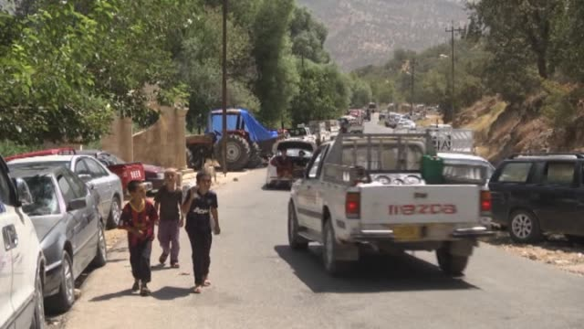 iraqi yazidis flee from sinjar due to attacks of army groups led by islamic state to lalesh enshrined kurdish city of dohuk iraq on august 5 2014... - sinjar stock videos & royalty-free footage