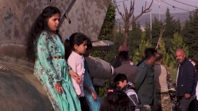 iraqi-kurdish children play near the monument for victims of the halabja gas massacre that killed some 5,000 people as they mark the 31th anniversary... - chemical stock videos & royalty-free footage