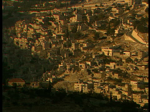 Jerusalem EXT Rooftops as seen from a distance / Sun rise over Jerusalem skyline and surrounding valley / Day dawning over city / Knesset building /...
