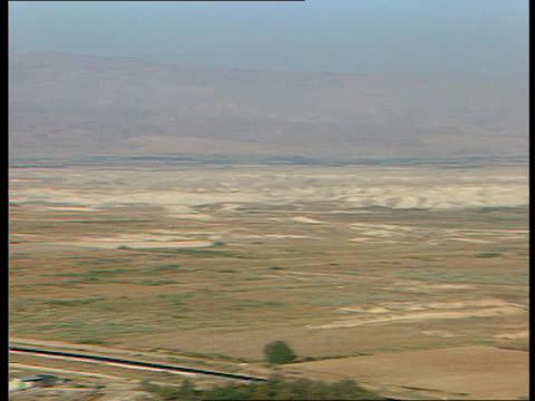 jerusalem ls valley and surrounding hills / military truck along country road / communications tower and mast seen on hilltop / night full moon over... - golfstaaten stock-videos und b-roll-filmmaterial