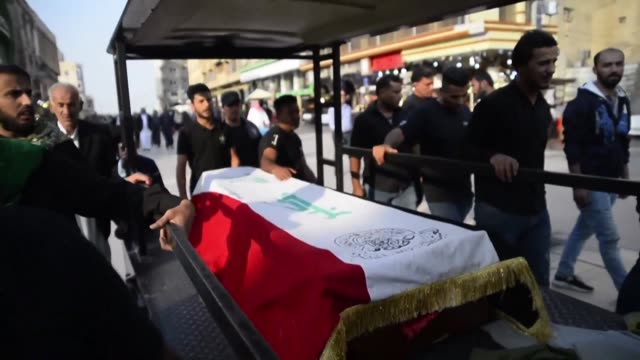 iraqis attend the funeral in najaf of protesters who were killed in baghdad and nasiriyah during anti governments demonstrations - najaf video stock e b–roll