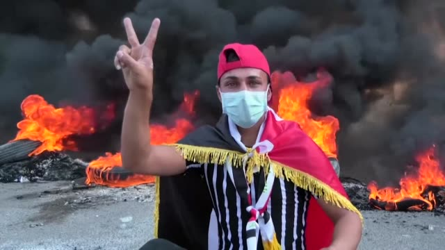 iraqis block the roads with burning tyres in the shiite shrine city of karbala south of iraq's capital baghdad during ongoing anti government protests - karbala stock videos & royalty-free footage