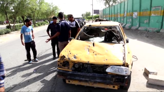 iraqis check the damage after a suicide bomber detonated an explosives-rigged vehicle in northern baghdad's sadr city on may 17, 2016 security and... - terrorism stock videos & royalty-free footage