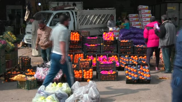 iraqis complain about rising food prices at a market in kerbala accusing retailers of taking advantage of the coronavirus crisis after the... - karbala stock videos & royalty-free footage