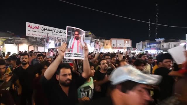 iraqis hold a symbolic funeral procession for renowned iraqi anti-corruption campaigner ihab al-wazni, in the southern iraqi city of nassiriya - iraq stock videos & royalty-free footage