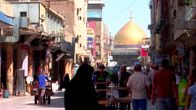 iraqis in the holy city of najaf are being hit hard by us sanctions on neighbouring iran which have forced cash strapped pilgrims to stay at home - najaf stock videos & royalty-free footage