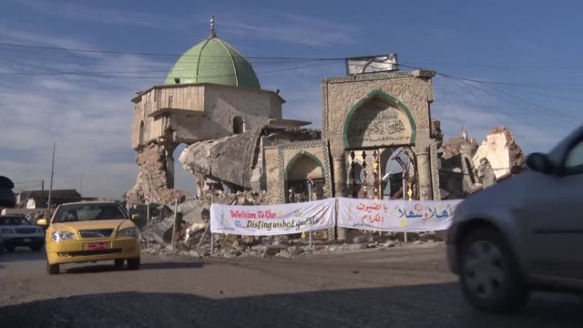 iraqis lay the cornerstone in rebuilding mosul's al nuri mosque and leaning minaret national emblems destroyed last year in the ferocious battle... - mosul stock videos and b-roll footage
