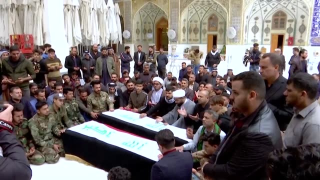 iraqis mourn members of the hashed al-shaabi paramilitaries who were killed in an area targeted by us military air strikes in the central iraqi holy... - najaf stock videos & royalty-free footage