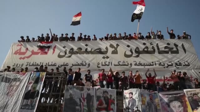 stockvideo's en b-roll-footage met iraqis rally in the southern city of nasiriyah in dhi qar province on the first anniversary of a revolt against a political system failing to deliver... - nasiriyah