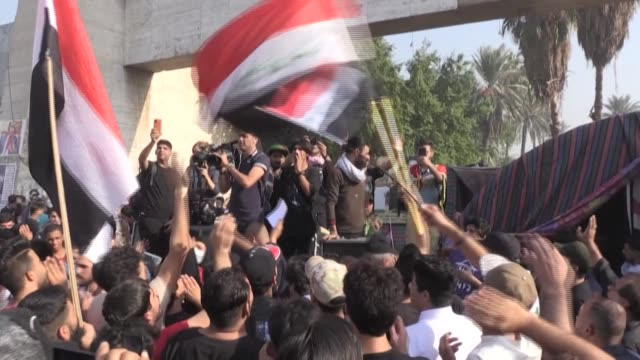 iraqis rally on baghdad's iconic al-jumhuriya bridge on the first anniversary of a revolt against a political system failing to deliver basic... - anniversary stock videos & royalty-free footage