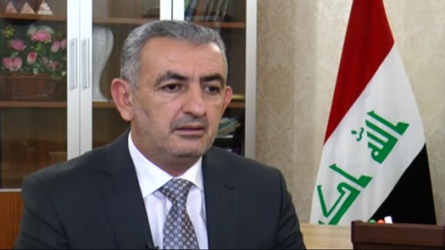 iraq's anbar province governor sohaib al-rawi speaks about the iraqi army operation in fallujah during an exclusive interview in baghdad, iraq on... - al fallujah bildbanksvideor och videomaterial från bakom kulisserna