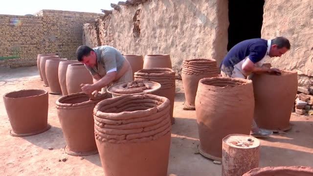 iraq's ancient pottery culture in the holy city of najaf is dying out with the increasing demand for more modern products - najaf stock videos & royalty-free footage