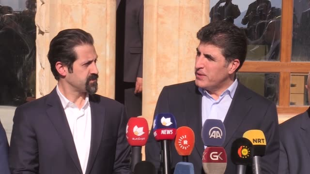 iraq's kurdish regional government prime minister nechirvan barzani speaks to the media as he visits areas struck by the sunday night's deadly... - イラク点の映像素材/bロール