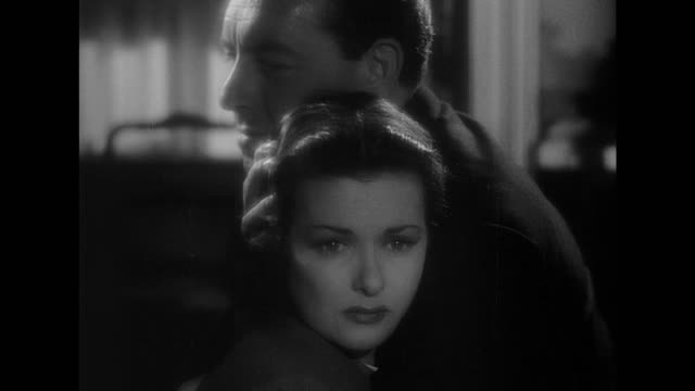 1948 irate man hits distraught woman and then pleads for her believe in him - film noir style stock videos & royalty-free footage