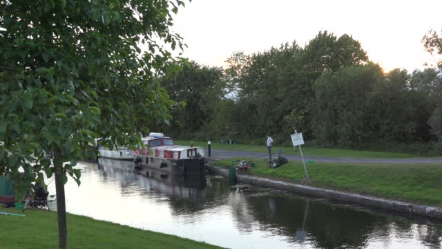 ireland boats on a canal in evening - canal stock videos & royalty-free footage
