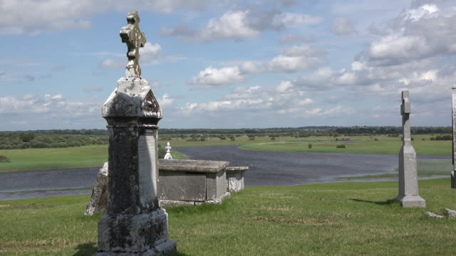 Ireland Clonmacnoise tombstones above the River Shannon