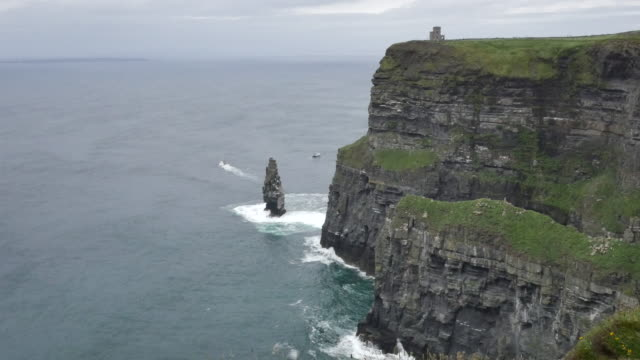 Ireland County Clare Cliffs of Moher with sea stack and tower