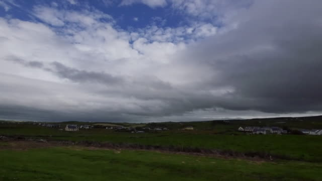 ireland county clare dark clouds over doolin - doolin stock videos & royalty-free footage