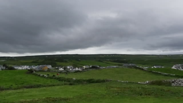 Ireland County Clare Doolin under dark cloudy sky pan