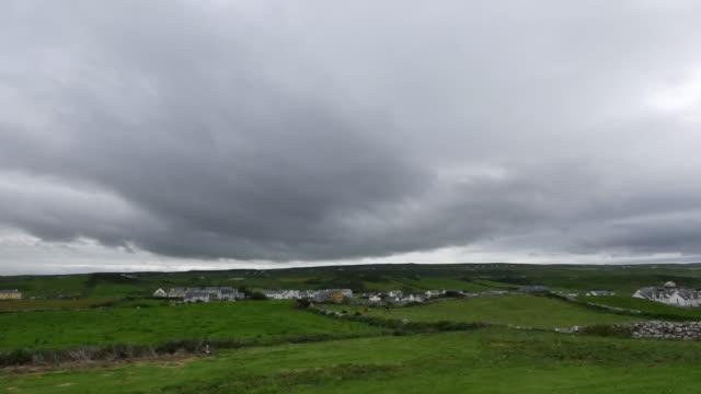 Ireland County Clare Doolin under dark cloudy sky
