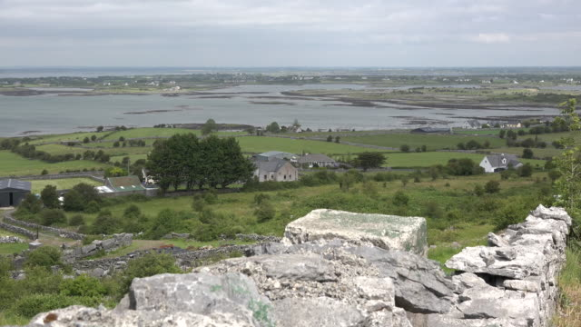 ireland county clare stone wall on hillside above estuary - stone wall stock videos and b-roll footage