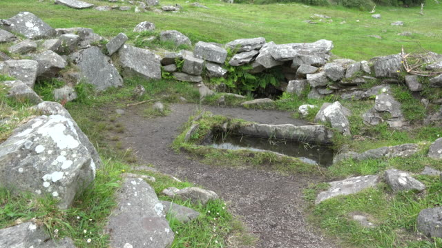 Ireland County Cork a rectangular pit or fulacht fiadh by a well at Drombeg.mov