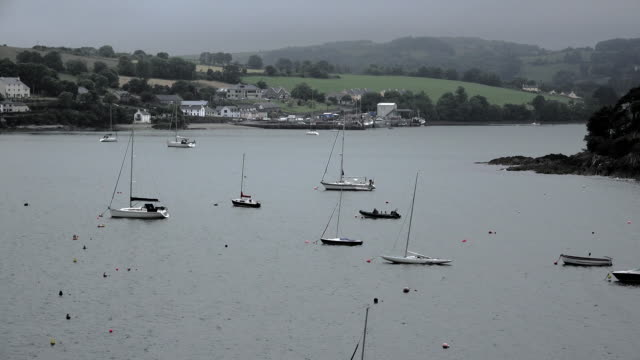 ireland county cork boats anchored at clendore terrace - county cork stock videos & royalty-free footage