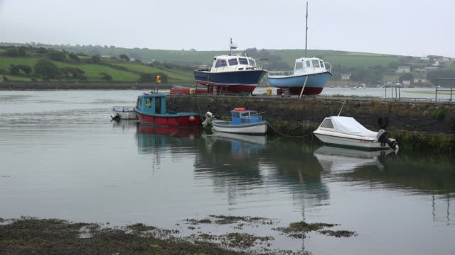 ireland county cork waterfront with boats on dock - county cork stock videos & royalty-free footage