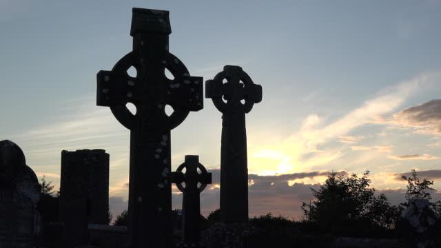 Ireland County Sligo three Celtic crosses at sunset pan