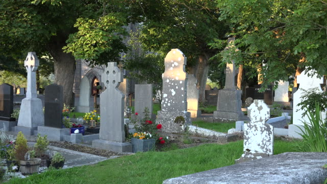 ireland county sligo tombstones in the drumcliff cemetery - cemetery stock videos & royalty-free footage
