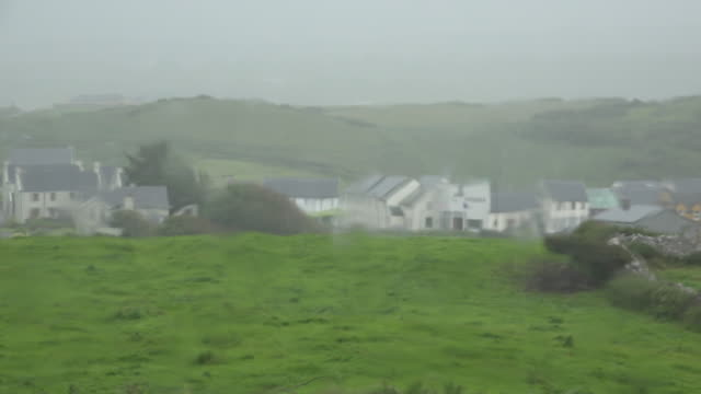 Ireland Doolin village through rain on window
