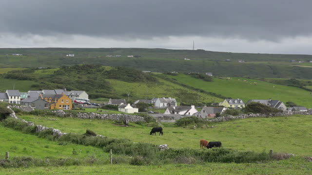 ireland doolin village under dark clouds pan - doolin stock videos & royalty-free footage