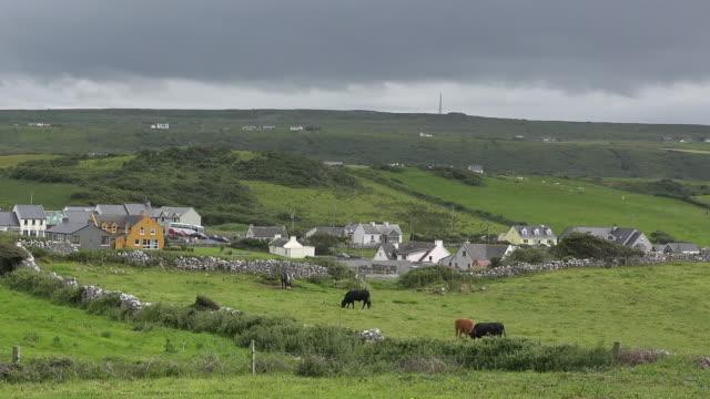 Ireland Doolin village under dark clouds pan