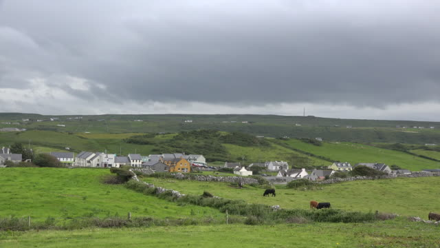 ireland doolin village under dark clouds - doolin stock videos & royalty-free footage