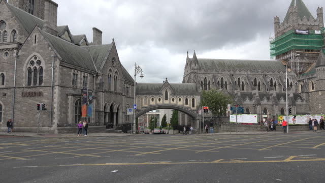 ireland dublin christ church cathedral arch connecting to dublinia - anglican stock videos & royalty-free footage