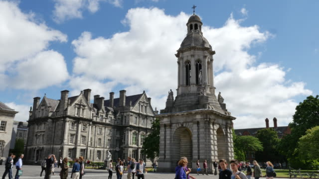 ireland dublin trinity college with bell tower and students - school bell stock videos and b-roll footage