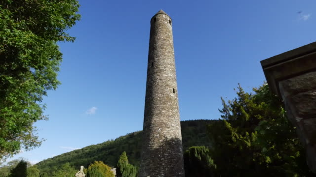 ireland glendalough round tower at celtic monastery ruin - schist stock videos and b-roll footage