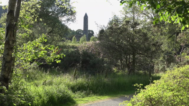 ireland glendalough round tower in distance - footpath stock videos & royalty-free footage