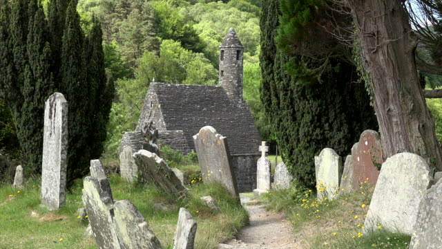 ireland glendalough with cemetery and st kevins church zoom in - old ruin stock videos and b-roll footage